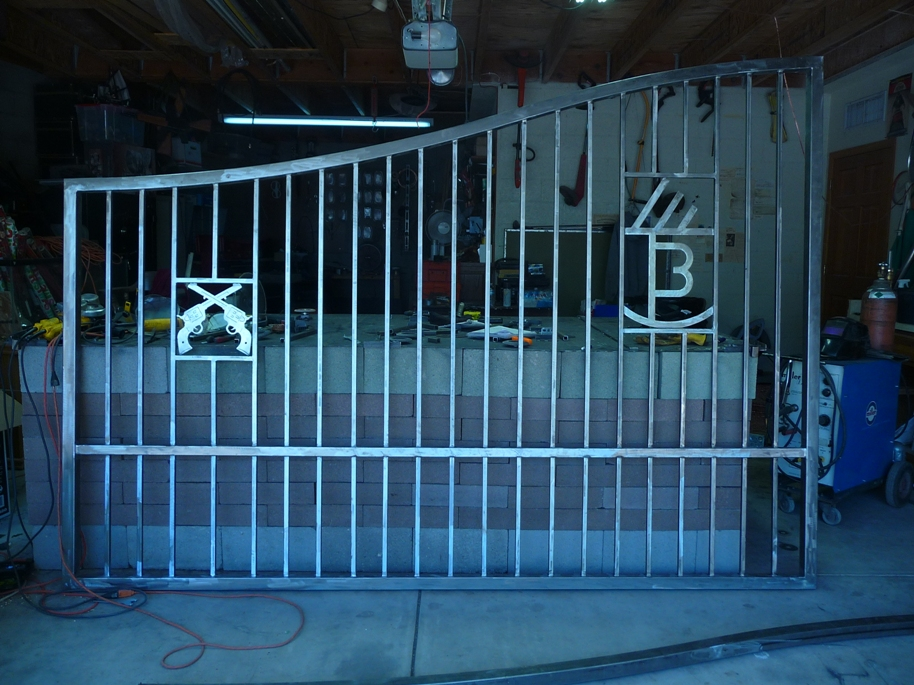 Custom Built Driveway Gates with Ranch Brands or Logos Installed.